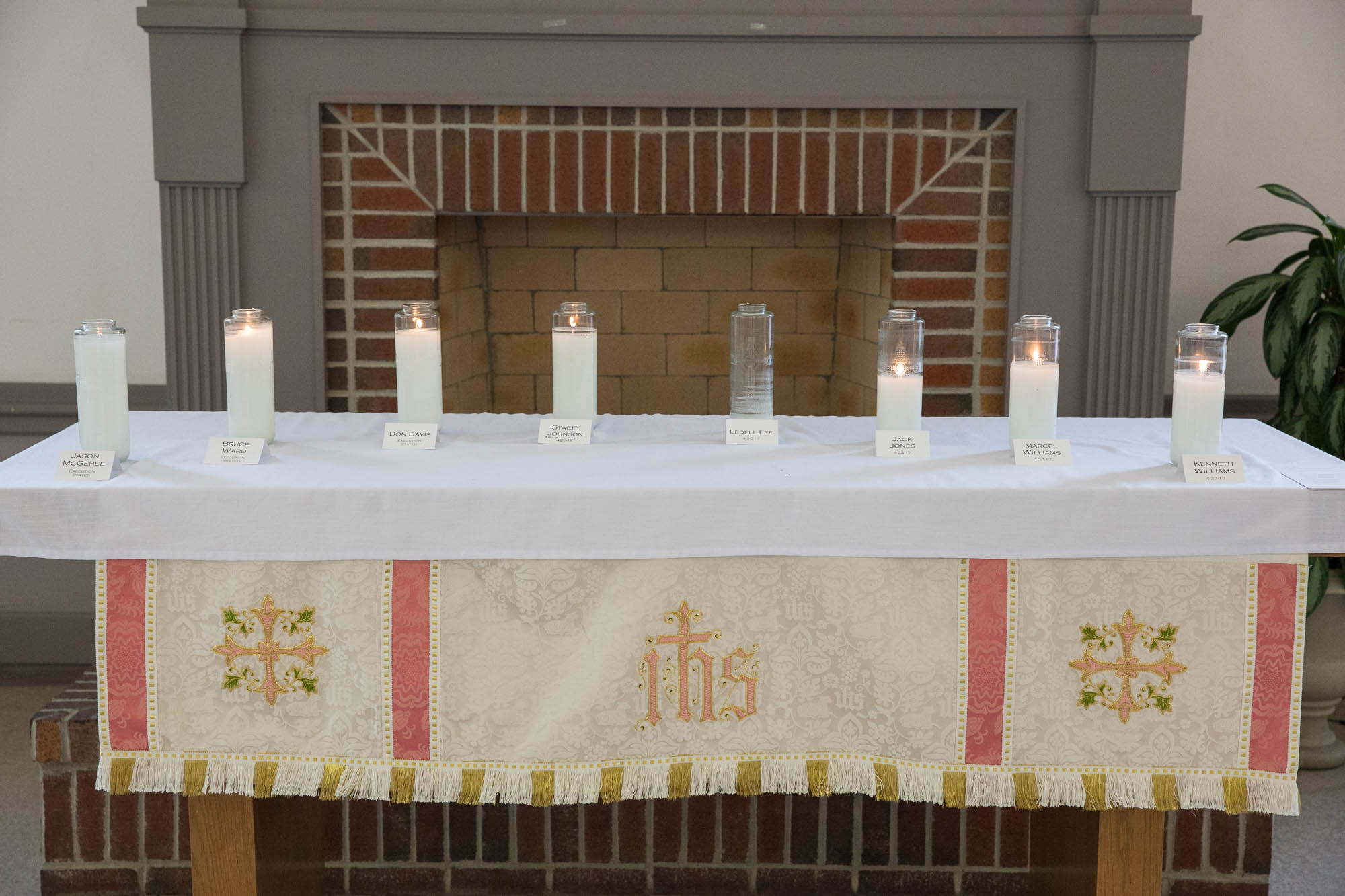 Candles for the eight men on a church altar