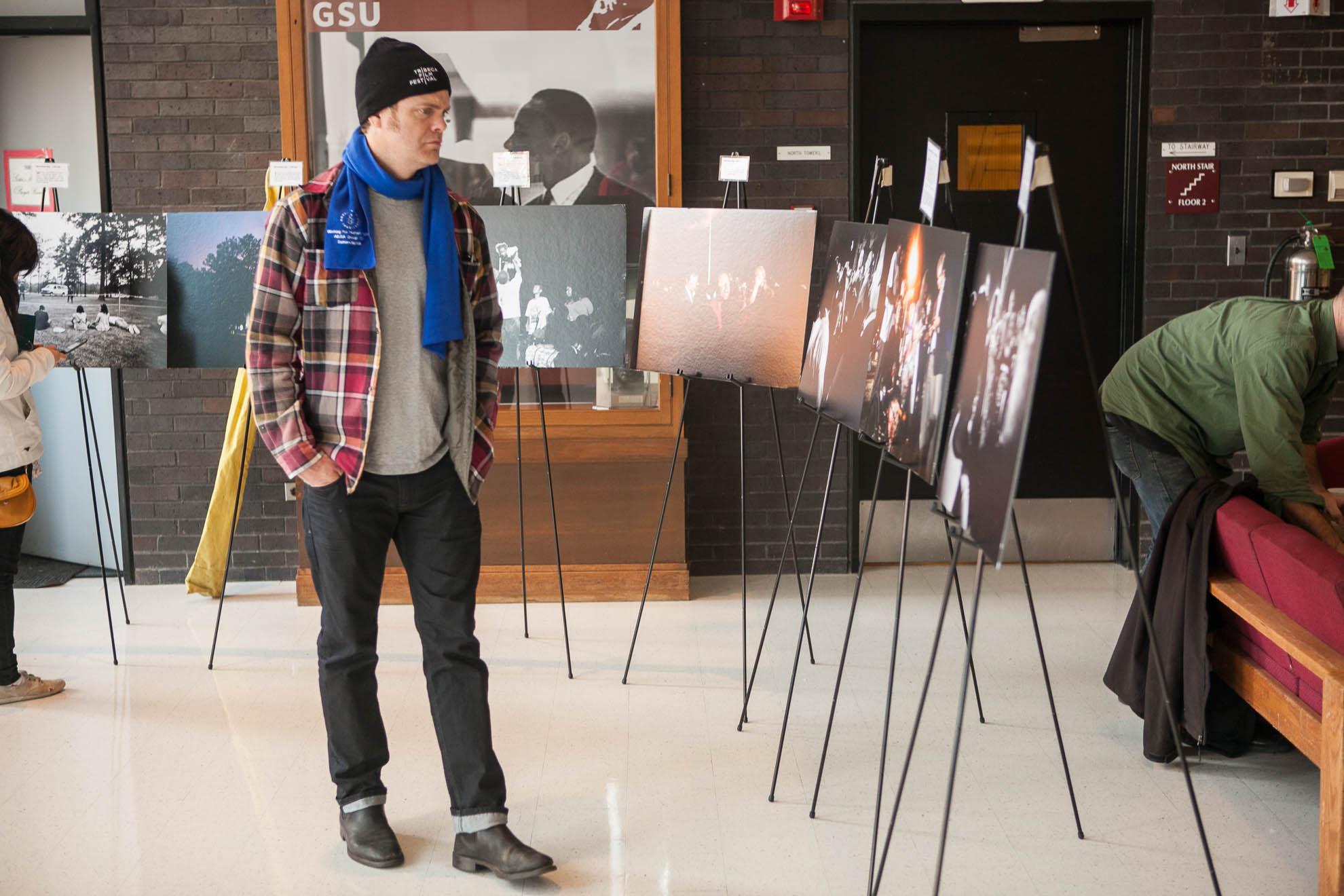 Actor Rainn Wilson views the photo exhibit at Boston University